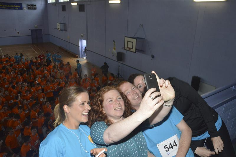 Teachers Claire Kelly , Caroline Kingston , Conor Mitchell and Carol Browne invent the selfie in 2014 with a 'sea of orange' behind them .jpg